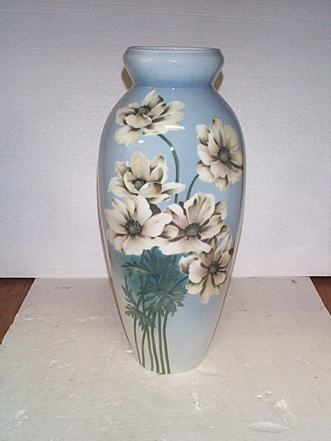 510: Oversized hand painted tall vase depicting flowers