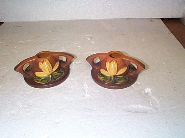 519: Pair of Roseville waterlilly single candlesticks,