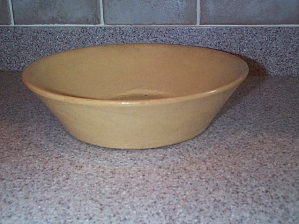 """7: yelloware bowl has a minute chip under rim 3"""" tall 9"""