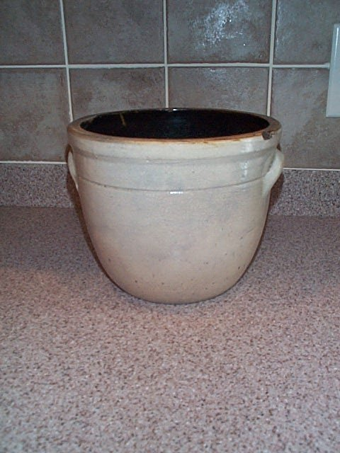 13: stoneware double handled crock has some hairline cr