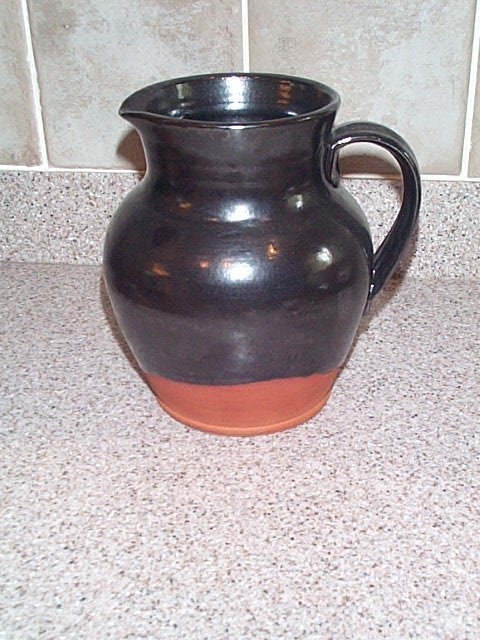 23: earthenware pouring vessel signed valley forage rep