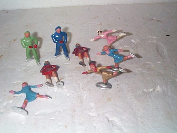 584: Lot of 8 Cast Iron Ice Skating Figurines, Buyer to
