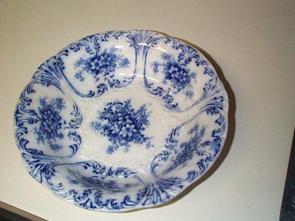 "803: Unsigned flow blue bowl.  9.5"" in diameter.  Buyer"