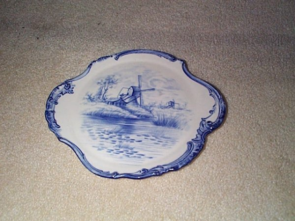 810: Signed Royal Bonn blue & white trivet with windmil
