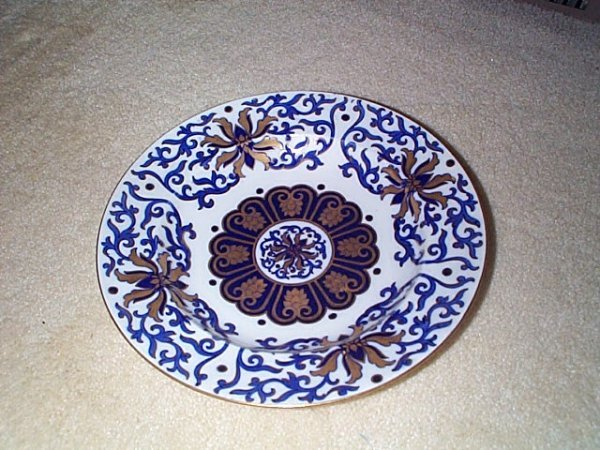 812: Wonderful hand-painted signed Coalport soup bowl.