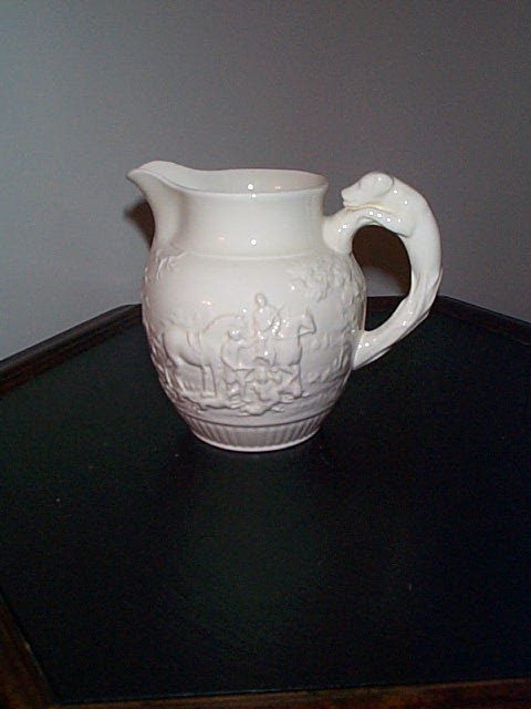 817: Signed Wedgewood pouring vessel with horse hunting
