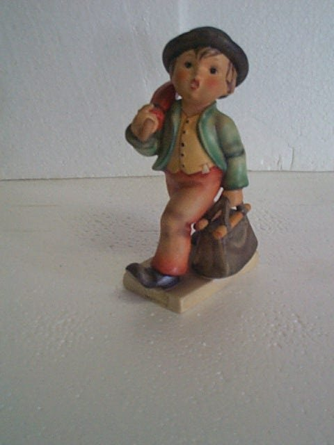 7: Hummel figurine oversized boy walking with umbrella