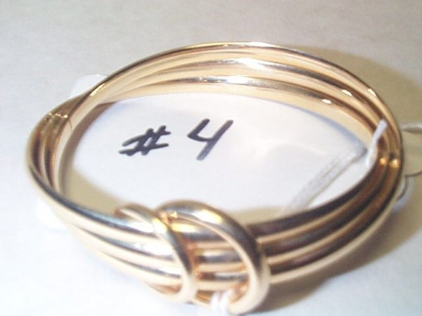 10A: 14K YG BANGLE 13.0 G. Buyer to pay $10.00 shipping