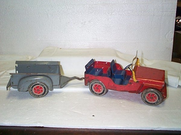 518: Willy's toy jeep with pull trailer.  Pressed steel