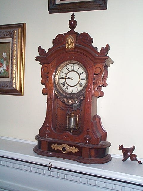 951: Victorian mantle clock with a mercury glass pendul
