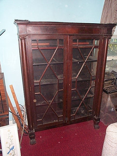 963: Empire bookcase with individually pained glass doo