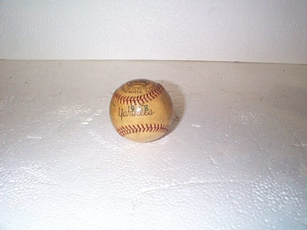 520: Signed 1958 NY Yankees game ball.  Appears to have