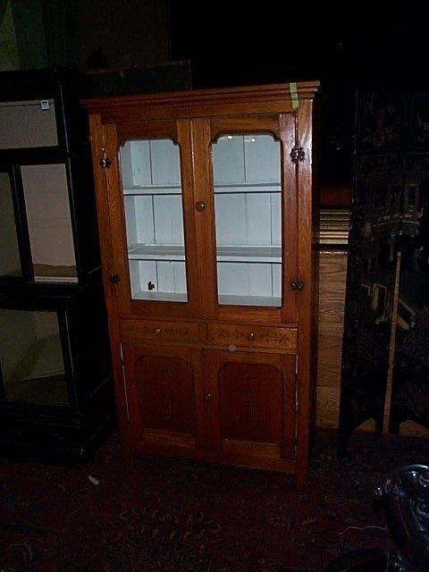 670: Oak china closet with pie safe base.  Local delive