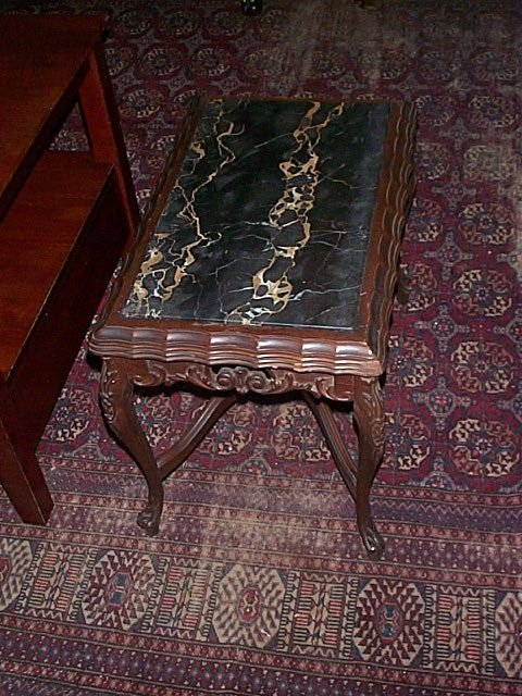 672: Carved walnut marble-topped coffee table.  Local d