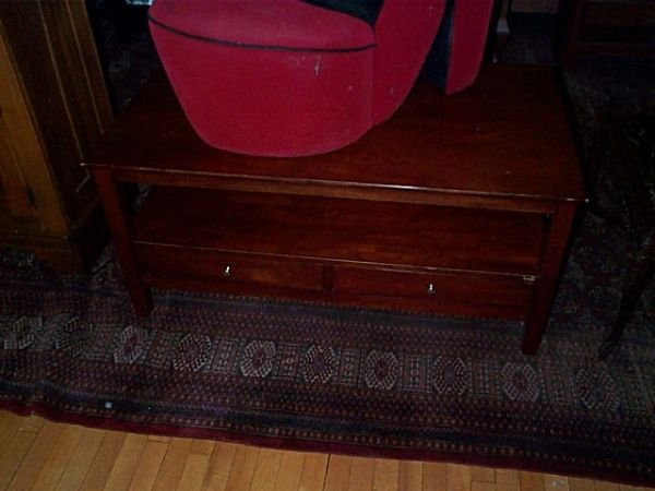 673: Cherry coffee table with two drawers.  Local deliv
