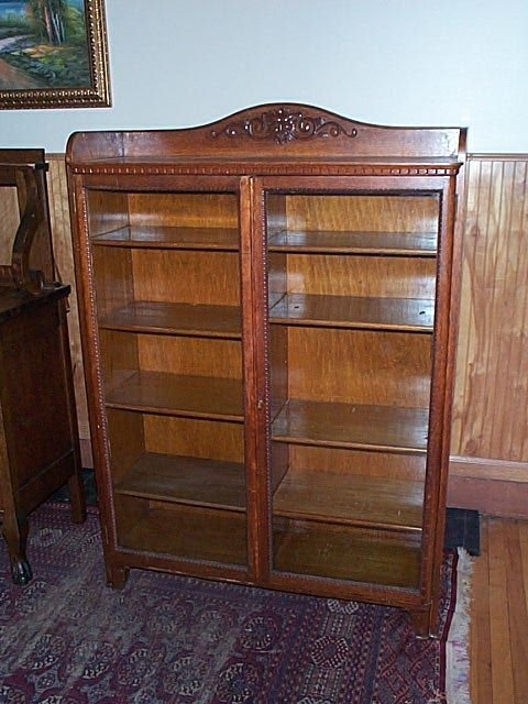676: Carved oak bookcase with hand-carved Northwind fac