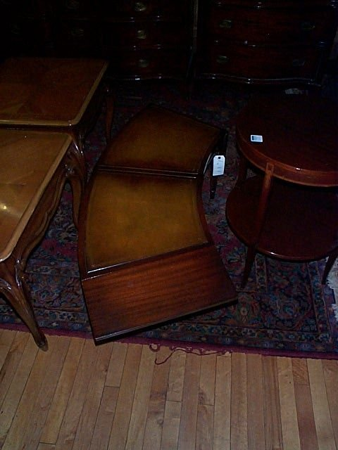 680: Mahogany leather-top drop-leaf curved coffee table