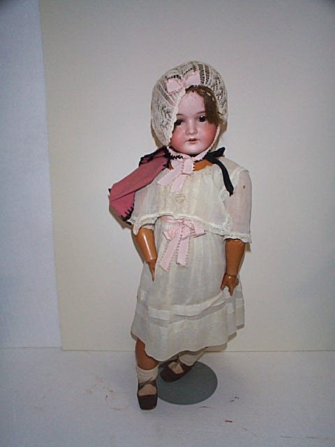 "604: Bisque head porcelain doll.  Head marked ""1916 #8."
