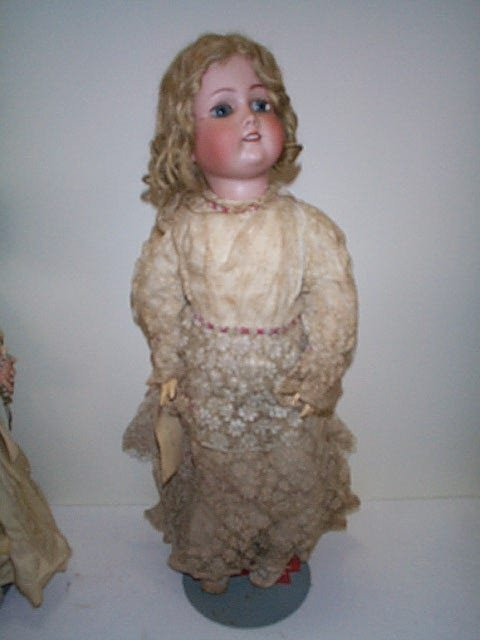 605: 19th. C German porcelain head doll.  Signed Simon