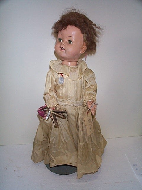 "606: 21"" composition girl doll in a confirmation outfit"