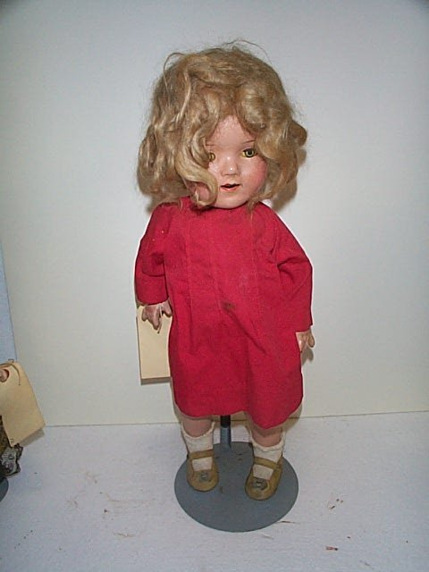 "607: 19"" composition Shirley Temple doll.  Marked ""EC U"