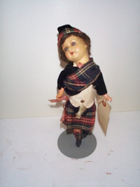 "611: 13"" Scottish girl doll.  Made of papier mache.  He"