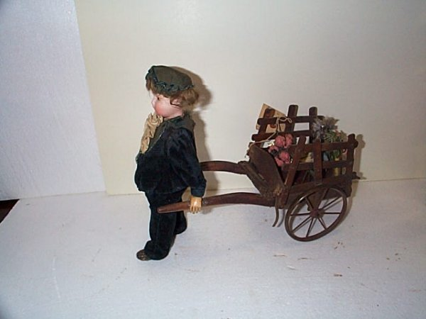 "617: 12"" French type boy, flower vendor with cart, doll"