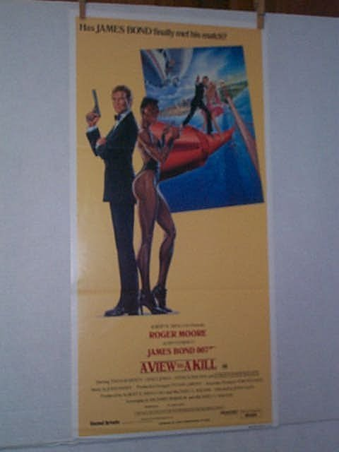 10: Original movie poster. ROGER MOORE AS, IAN FLEMMING