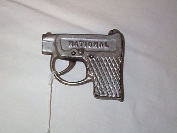 1: 1915 National Cap Gun, measures 3 3/4 in. long, in g