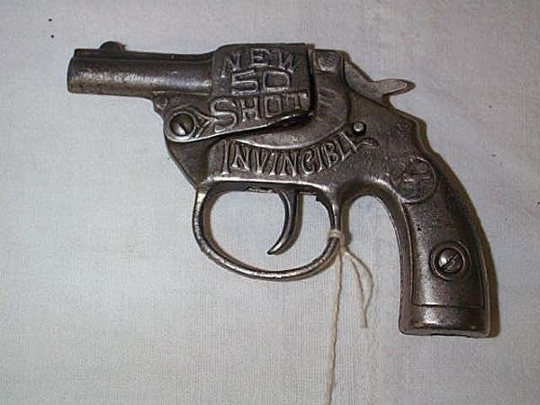 6: 1925 Kilgore invincible new 50 shot cap gun, measure