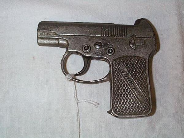 12: 1920's National cap gun, measures 4 1/4 in., in goo