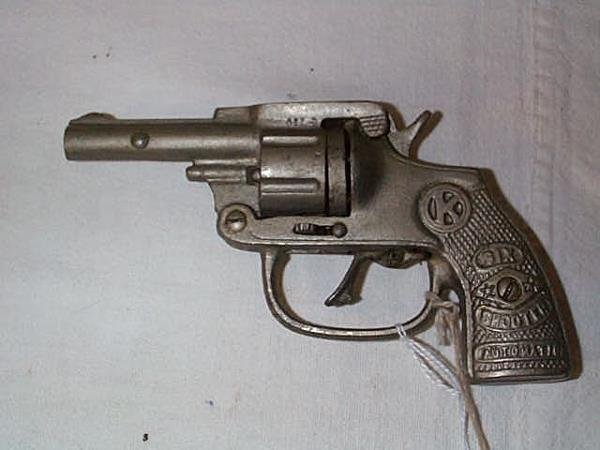 13: 1930's Kilgore six shooter automatic, measures 6 in