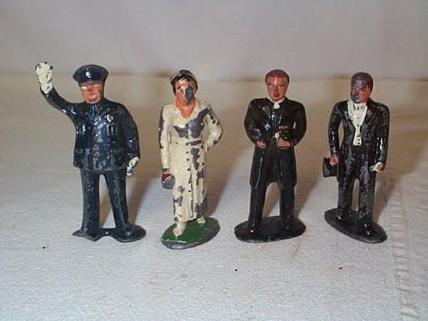 21: Lot of (4) Lead figurines including Nurse, Policema