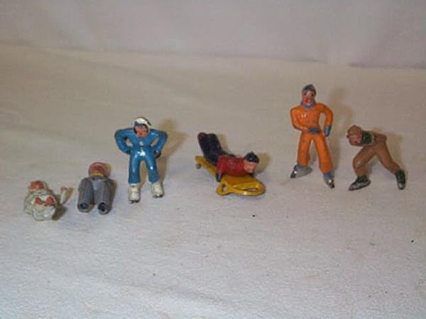 23: Lot of (6) Lead figurines including (1) skier, (2)