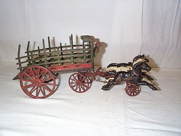 52: Early Cast Iron Horse Drawn Wagon unsigned, could b