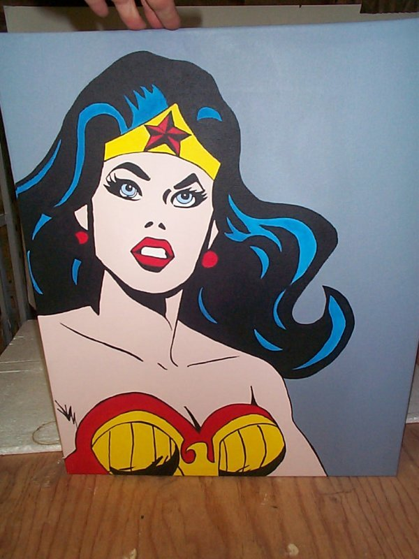 5: An original oil on canvas depicting Wonder Woman.  M