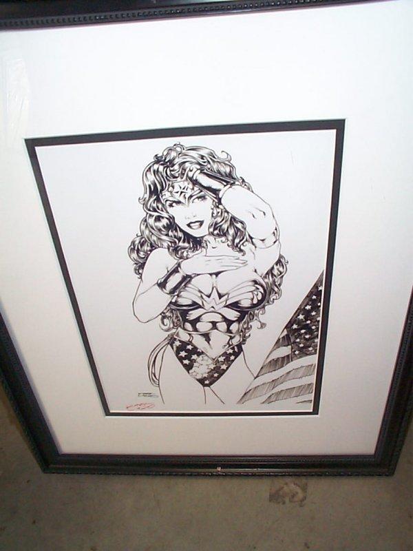 20: Framed print depicting Wonder Woman.  Artist signed