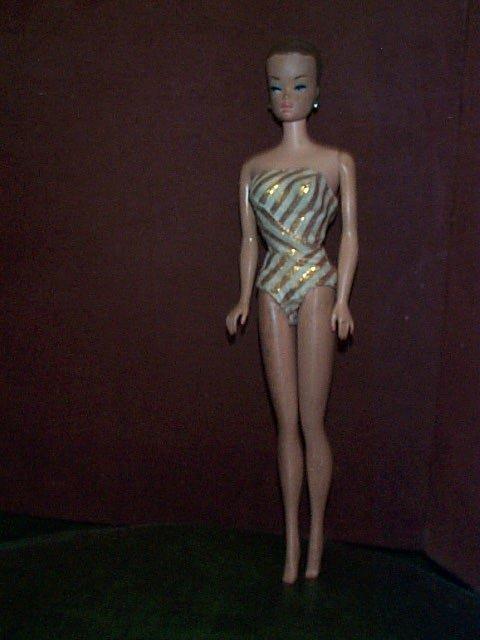 "850: Mattel Midge 1968 doll  Measures 11.5"" tall  Buyer"