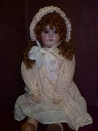 880: Antique porcelain head doll with a composition joi