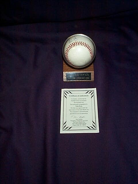 5: Signed autographed baseball by Nolan Ryan, comes wit