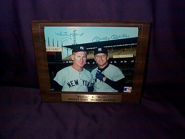 7: Framed plaque photograph of Whitney Ford and Mickey