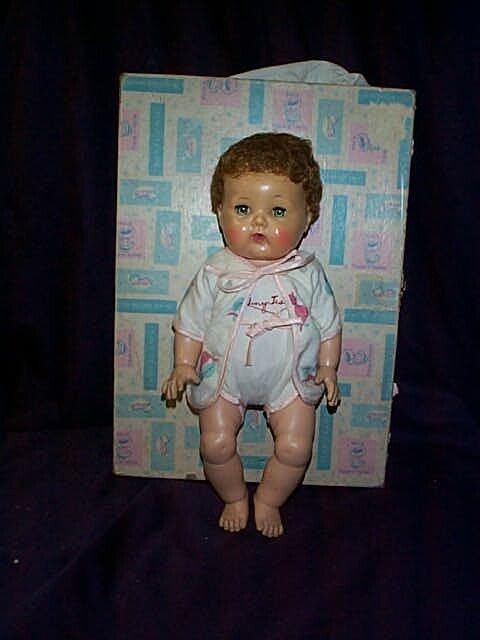 """109: A tiny tears doll with original box. Measures 15"""""""