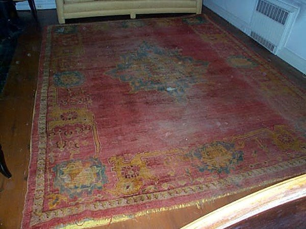 1222: Antique hand made Oriental Rug. Measures 9' by 11