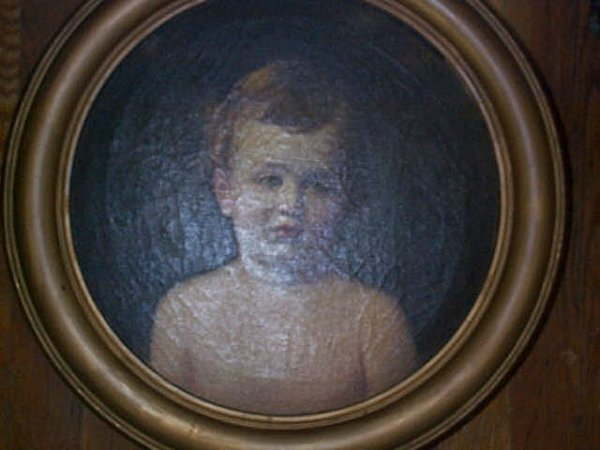 950: 19th Century oil on canvas depicting a young boy p