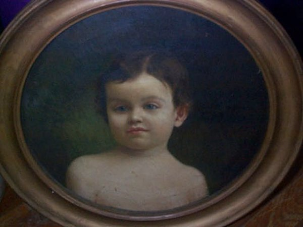 951: 19th Century oil on canvas depicting a young boy p