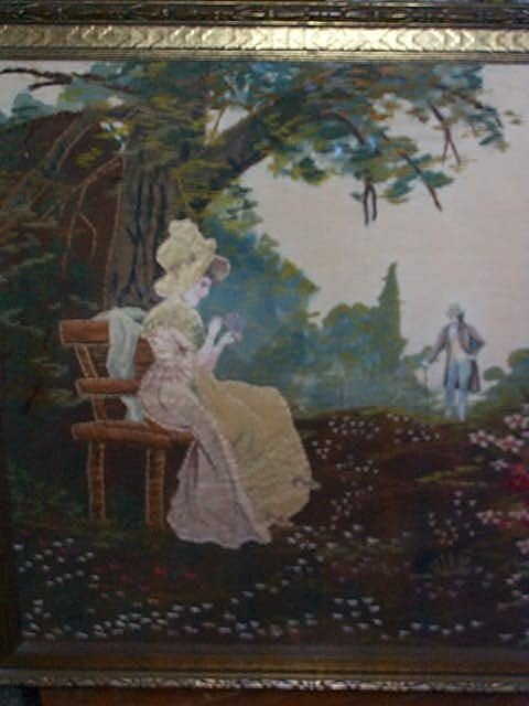 956: Hand embroidered picture depicting a women seated