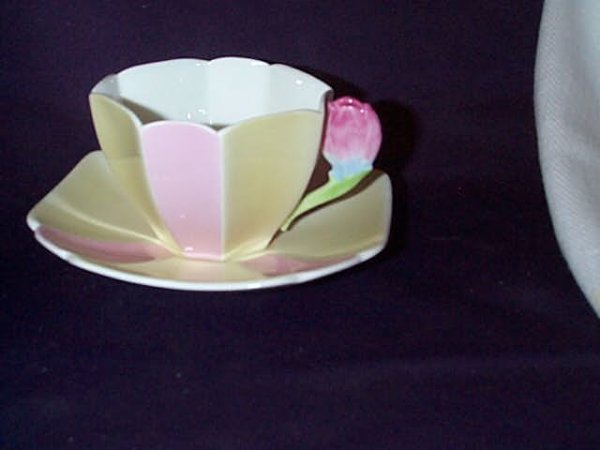 1276: Unusual Shelley cup and saucer Rd #723404, hand p