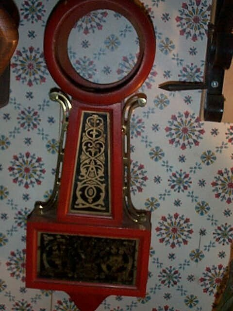 3: Banjo clock case. Case painted Red, glass has gold d