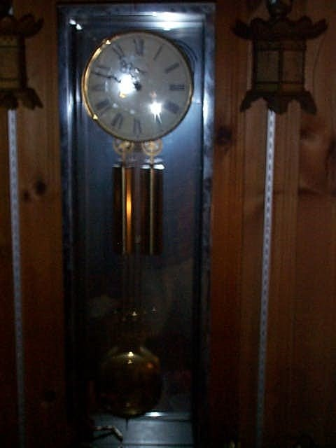 5: Howard Miller modern clock in glass case with mirror