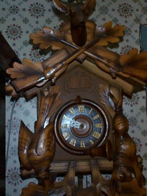 11: German Coo-Coo clock top crest contains a deer buck